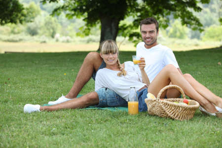 Couple picnicking in the countryside photo