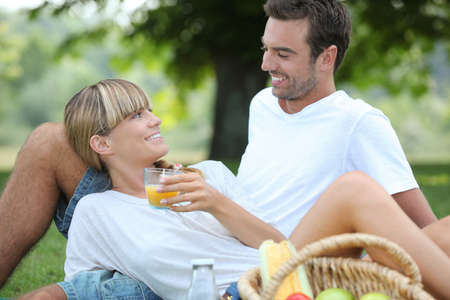 Couple relaxing on the grass photo