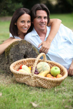 mid adult couple: A middle age couple having a picnic. Stock Photo
