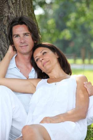 faithful: romantic couple in the park Stock Photo