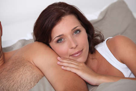 hairy arms: Woman leaning against her husband Stock Photo