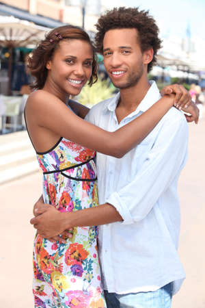 moreno: Couple embracing on the street Stock Photo