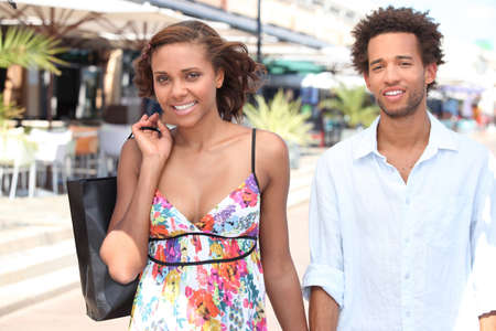 cool attitude: black young couple walking in the street