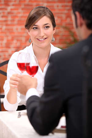 wooing: Couple drinking rose wine in a restaurant