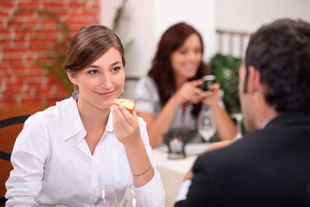 Couple enjoying meal in a restaurant photo