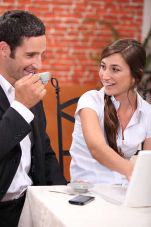 Couple with laptop in restaurant photo