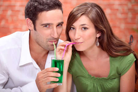 Couple drinking cocktails photo