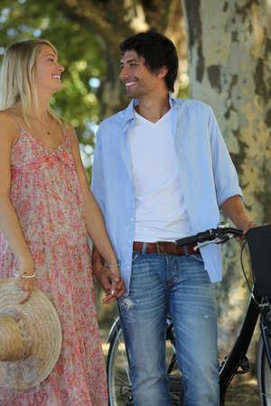 maxi dress: Romantic couple with a bike