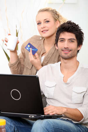 young couple shopping online photo