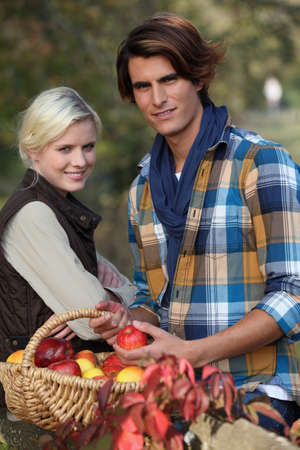 Young couple picking apples photo