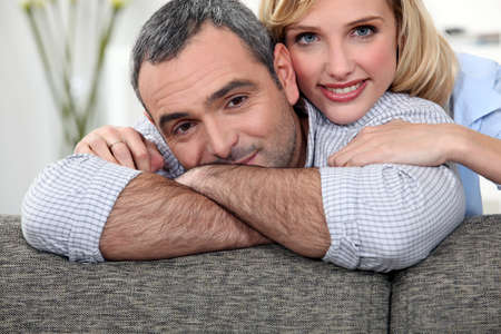 40 years old: couple leaning on a sofa