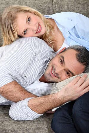 cherishing: Loving couple sitting on a sofa