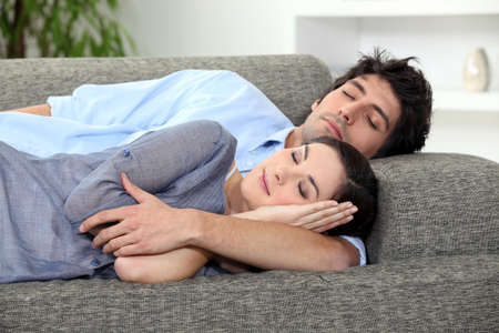 Couple asleep on sofa photo