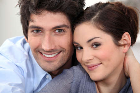 Couple sat hugging at home Stock Photo - 14104856