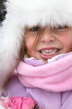 Cute little girl in snowsuit photo
