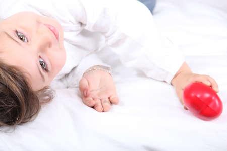 plastic heart: Child holding a plastic heart