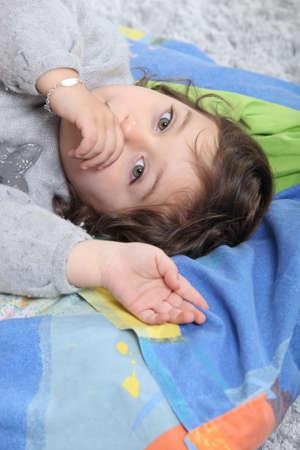 Child sucking her thumb photo