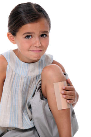 minors: Young girl with an enormous plaster on her leg