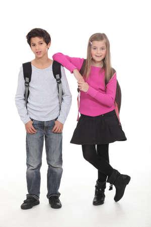 back pack: Two school children wearing backpacks