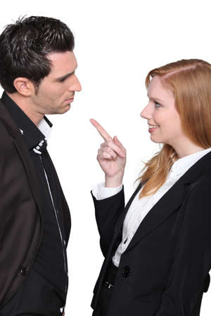 derision: Businesswoman pointing at man Stock Photo