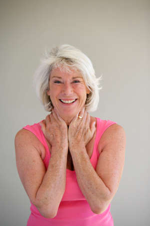 exuberance: Excited gray-haired lady Stock Photo