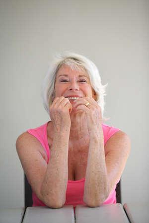 landlady: Mature woman sat in the garden laughing