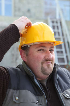 Builder scratching his head photo