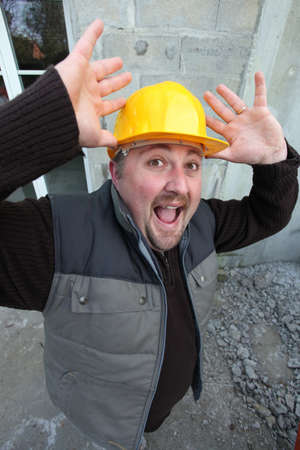 Alarmed construction worker photo