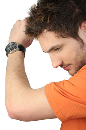 Casual young man wearing wrist watch photo