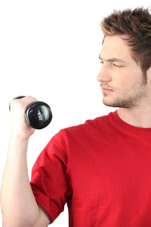 kilos: Man lifting a two kilos barbell Stock Photo
