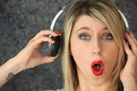 woman open mouth: Woman listening to loud music