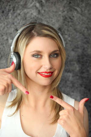 Woman listening to music on headphones Stock Photo - 14106763