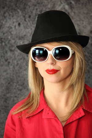 puckered lips: Woman with sunglasses and hat