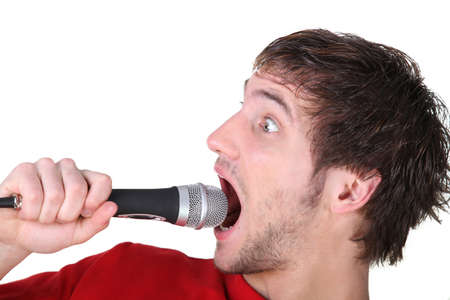 squeal: Man shouting into a microphone
