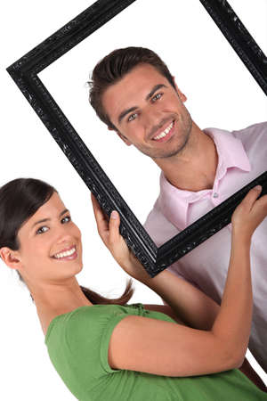 black woman white man: Couple with a picture frame