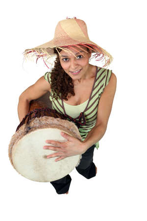 high angle shot: portrait of girl with djembe drum