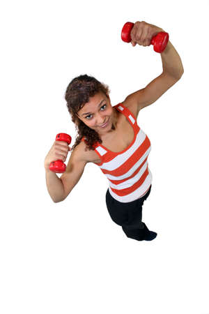Woman lifting weights over head Stock Photo - 14106250