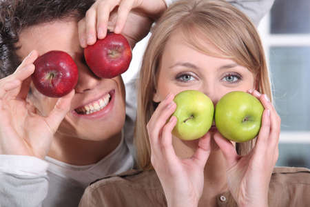 floor covering: Funny couple covering their eyes with apples