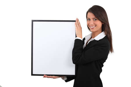 publicity: Attractive businesswoman with picture frame