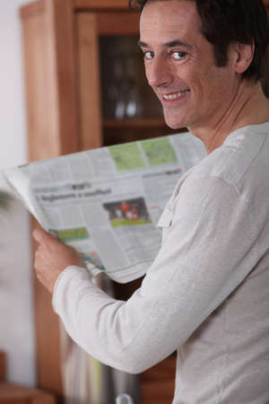 Man happy reading newspaper. Stock Photo - 14106777