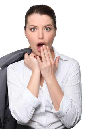business concern: Shocked businesswoman