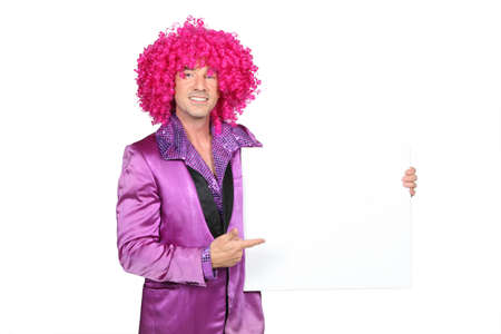 male costume: Man in silly seventies costume holding blank board ready for your message