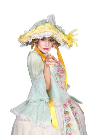 period costume: Woman in a theatrical outfit using her fingers as a pretend gun