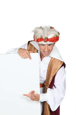 seething: Man dressed in genie costume