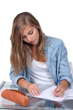 Girl doing homework photo
