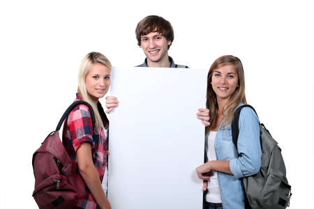 cheery: Teenagers holding up a blank poster