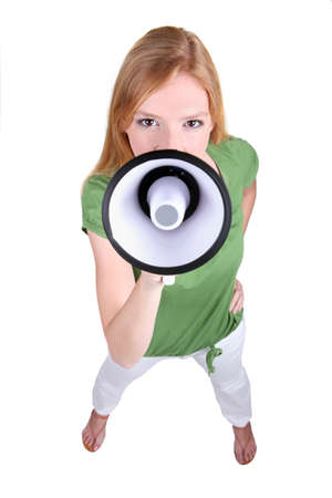 Ginger haired girl speaking into megaphone photo