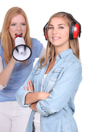 ear protection: Teenager shouting in loud speaker