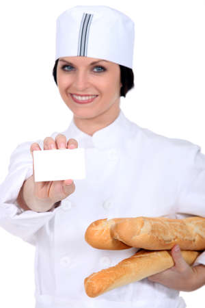 salesgirl: salesgirl in bakery shop holding business card