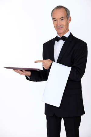 alcohol server: 60 years old waiter showing his trail